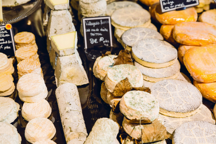 A cheese shop full of artisan cheese in Bordeaux on a river cruise in France