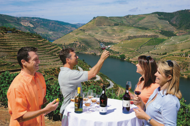 River cruises guests wine tasting on a Douro voyage