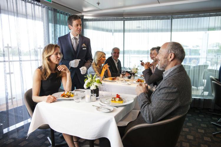 Couple enjoying dinner on-board Scenic