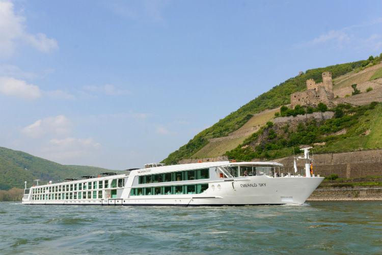 Emerald Sky sailing along a river