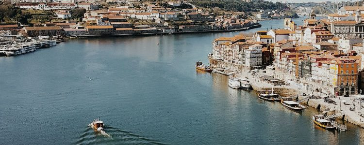 Ship sailing along the river Douro