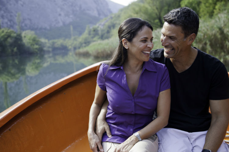 Couple on-board boat for a river cruise shore excursion