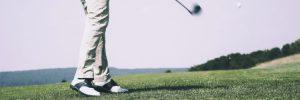 Man playing golf, mid-swing