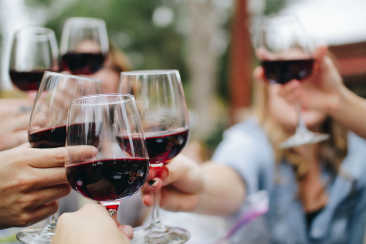 Group clinking glasses of wine