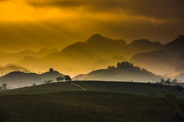 Panoramic view of the sun setting over Vietnamese hills