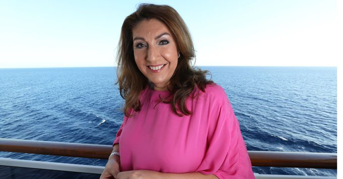 Jane McDonald posing for photographs on the balcony of a cruise ship