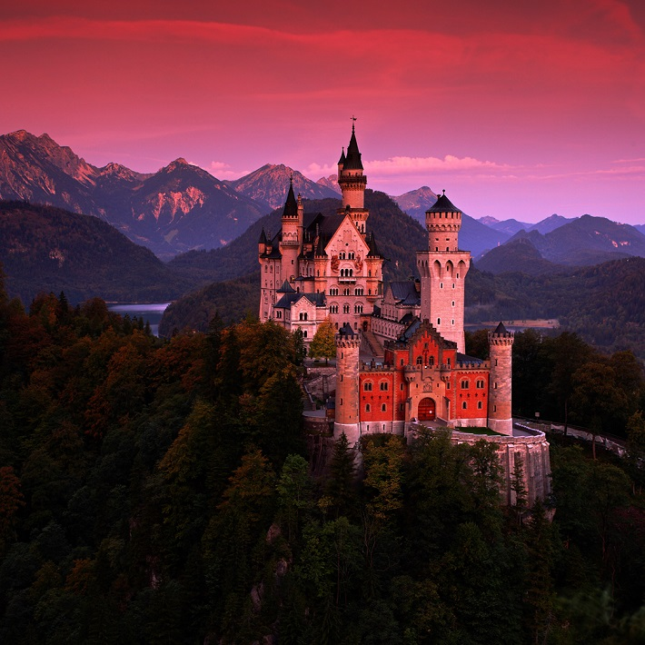 A castle in Germany seen along the Rhine at sunset