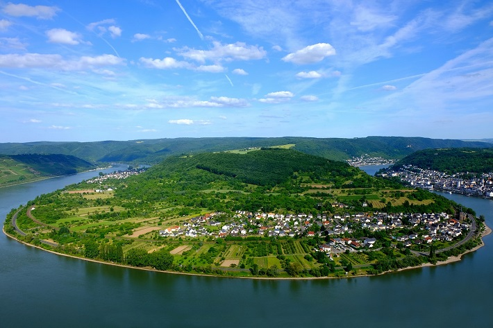 Bright green hills on a bend in the Upper Middle Rhine Valley
