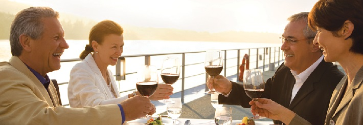 Guests enjoying a glass of wine on-board a Uniworld river cruise